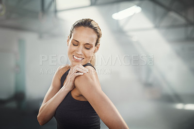Buy stock photo Cropped shot of a sporty young woman suffering from a sport's injury