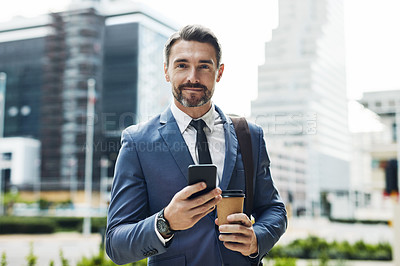 Buy stock photo Cropped portrait of a handsome mature businessman sending a text message while on his way in to work