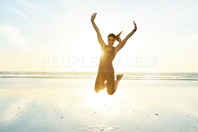 Buy stock photo Full length portrait of an attractive and athletic young woman working out on the beach