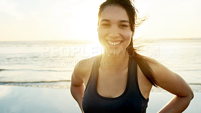 Buy stock photo Cropped portrait of an attractive and athletic young woman working out on the beach