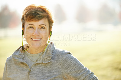 Buy stock photo Cropped portrait of an attractive mature sportswoman standing in the park during an early morning workout