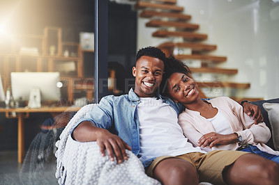 Buy stock photo Shot of a happy young couple relaxing together on the sofa at home