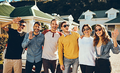 Buy stock photo Cropped portrait of a group of young friends waving at the camera while standing in a driveway outside