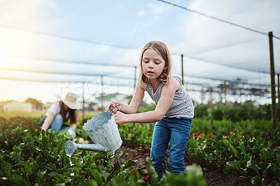 Buy stock photo Full length shot of a young mother and her little daughter working on the family farm