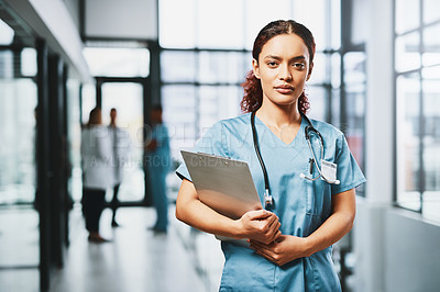 Buy stock photo Portrait of a young nurse standing with a clipboard in a hospital