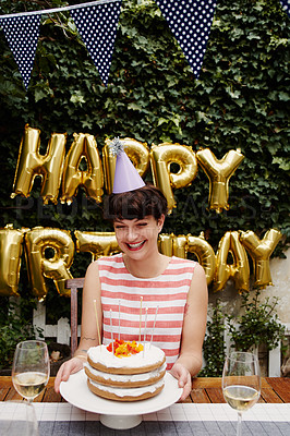 Buy stock photo Cropped portrait of an attractive young woman celebrating her birthday outdoors