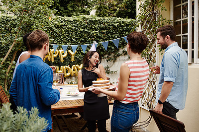 Buy stock photo Cropped shot of a group of friends celebrating a birthday outdoors