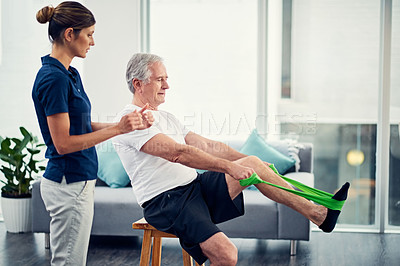 Buy stock photo Cropped shot of an attractive young female physiotherapist working with a senior male patient