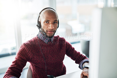 Buy stock photo Cropped portrait of a handsome young male call center agent working in his office