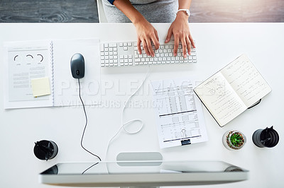 Buy stock photo High angle shot of an unrecognizable young businesswoman working at her desk in the office