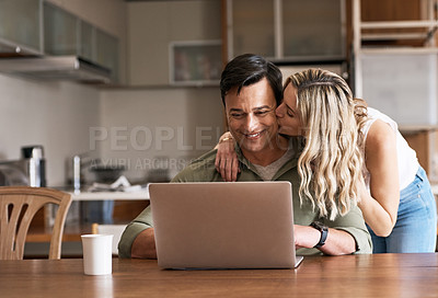 Buy stock photo Shot of a couple using a laptop together at home