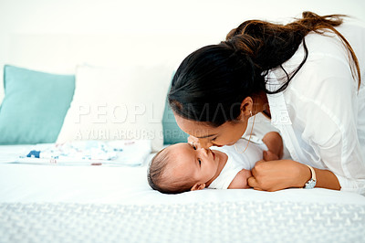 Buy stock photo Shot of a mother bonding with her baby boy at home