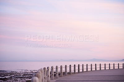 Buy stock photo Cropped shot of a promenade during sunset