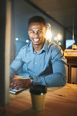 Buy stock photo Cropped portrait of a handsome young businessman working late at night in a modern office