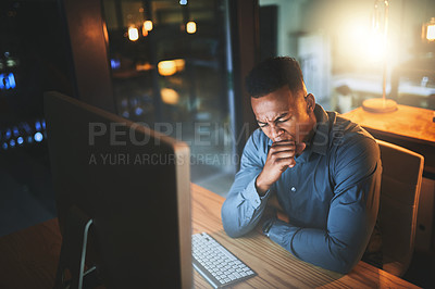 Buy stock photo Cropped shot of a young businessman yawning while working late at night in a modern office