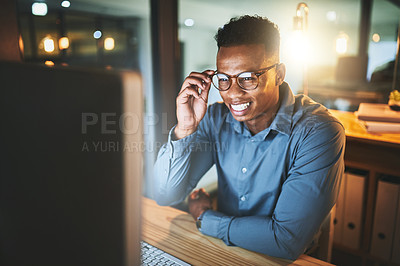 Buy stock photo Cropped shot of a handsome young businessman working late at night in a modern office