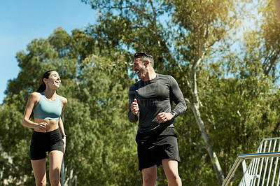 Buy stock photo Shot of a sporty couple exercising together outdoors