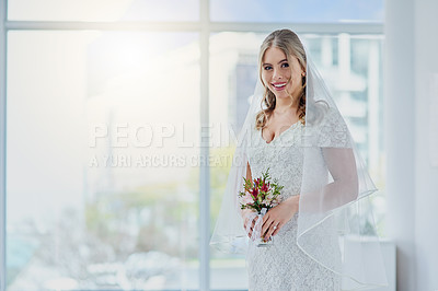 Buy stock photo Portrait of a beautiful young bride holding a bunch of flowers on her wedding day