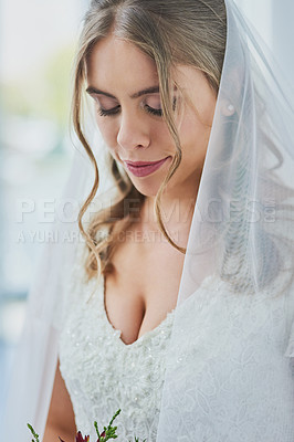 Buy stock photo Shot of a beautiful young bride on her wedding day