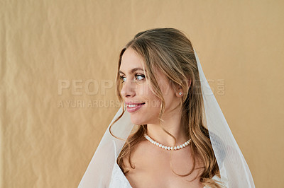 Buy stock photo Shot of a beautiful young bride on her wedding day against a wooden background