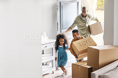 Buy stock photo Shot of a father and his two little children carrying boxes into their new home