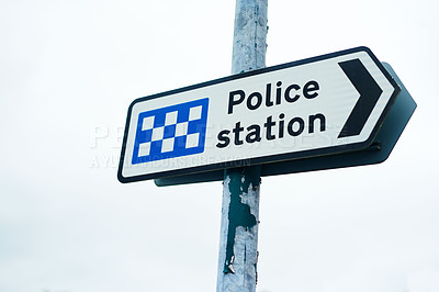 Buy stock photo Shot of a directional sign towards the police station