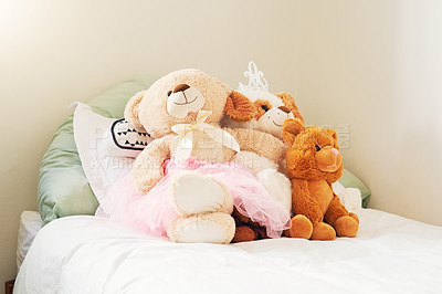 Buy stock photo Shot of teddy bears on a child's bed