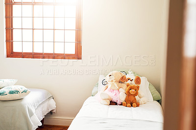 Buy stock photo Still life shot of teddy bears on a bed in a room