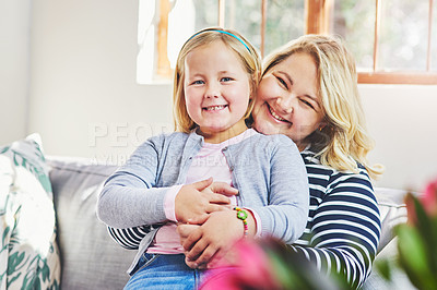 Buy stock photo Portrait of a mother and her little daughter bonding together at home