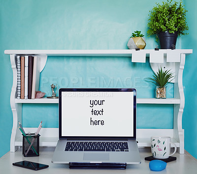 "Buy stock photo Shot of a laptop with the words, ""your text here"" on the screen on an office desk"