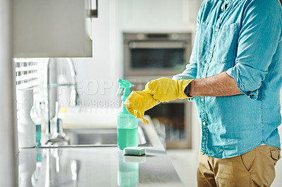 Buy stock photo Cropped shot of an unrecongizable man cleaning at home