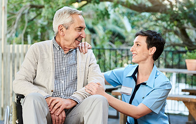 Buy stock photo Shot of a nurse caring for a senior patient in a retirement home