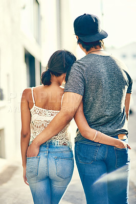 Buy stock photo Rearview shot of an affectionate couple standing together