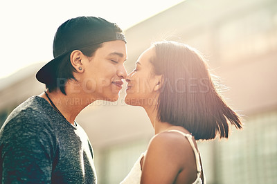 Buy stock photo Close-up shot of a loving couple spending the day out in the city
