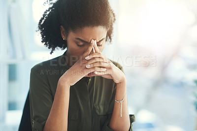 Buy stock photo Shot of a young businesswoman looking overly stressed in her office