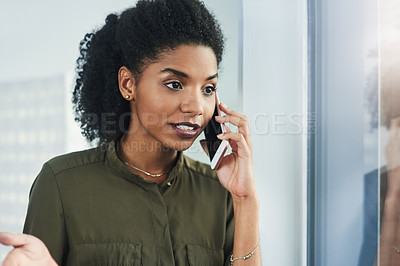 Buy stock photo Close up shot of a young businesswoman making a phone call in her office