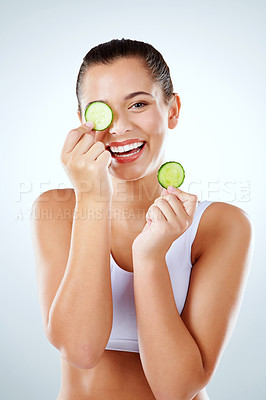 Buy stock photo Studio shot of an attractive young woman in exercise clothing against a gray background