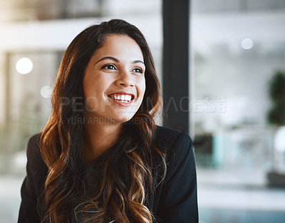 Buy stock photo Cropped shot of an attractive young businesswoman looking thoughtful while working in her office