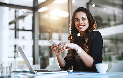 Buy stock photo Cropped portrait of an attractive young businesswoman sending a text message while working in her office