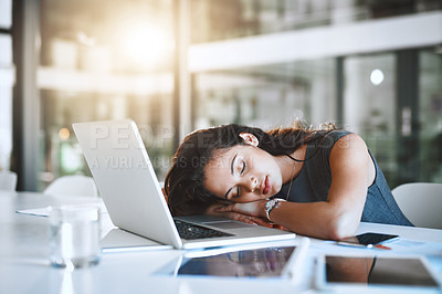 Buy stock photo Cropped shot of an attractive young businesswoman sleeping at her desk in the office