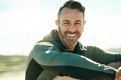 Buy stock photo Shot of a mature man taking a break during his workout