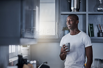 Buy stock photo Shot of a young man having coffee during a relaxing morning at home