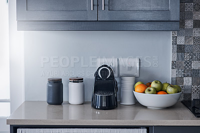 Buy stock photo Shot of a kettle, condiments and a bowl of fruit on a kitchen counter