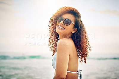 Buy stock photo Cropped portrait of an attractive young woman standing on the beach