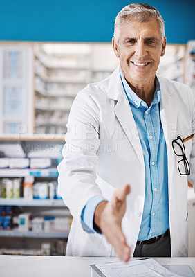 Buy stock photo Shot of a pharmacist extending his arm for a handshake