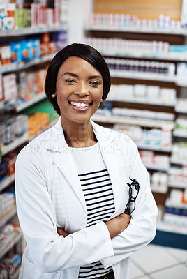 Buy stock photo Shot of a female pharmacist working in a drugstore