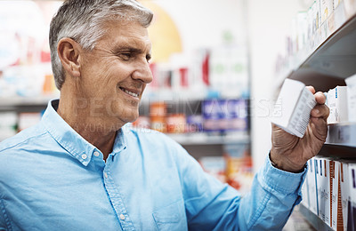 Buy stock photo Cropped shot of a customer browsing the shelves in a pharmacy