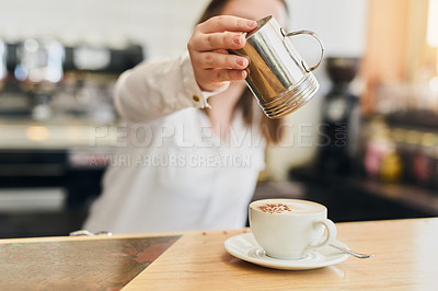 Buy stock photo Shot of a young woman in a coffee shop