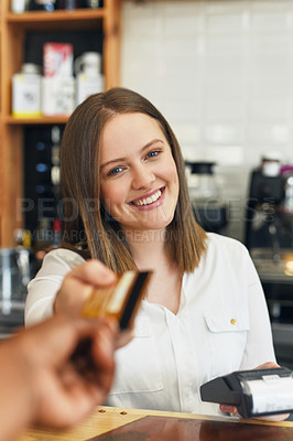 Buy stock photo Shot of a waitress accepting a credit card payment from a customer in a cafe