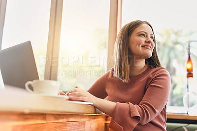 Buy stock photo Cropped shot of a young woman using her laptop in a coffee shop